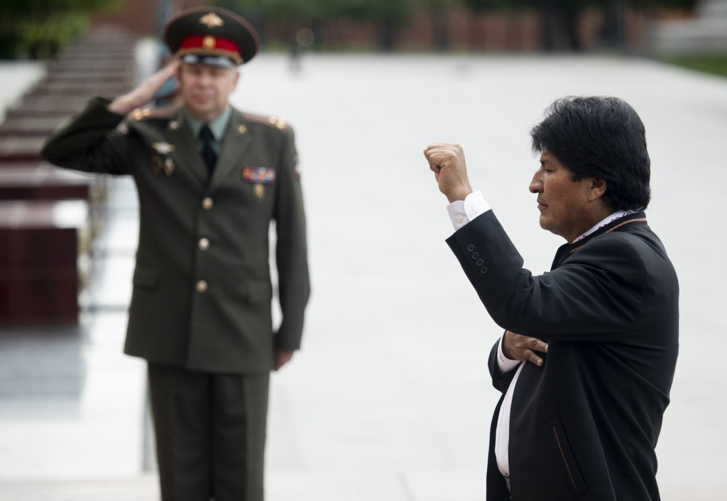 Bolivia's President Evo Morales salutes as he attends a wreath laying ceremony at the Tomb of Unknown Soldier in Moscow, Russia, Thursday, July 11, 20
