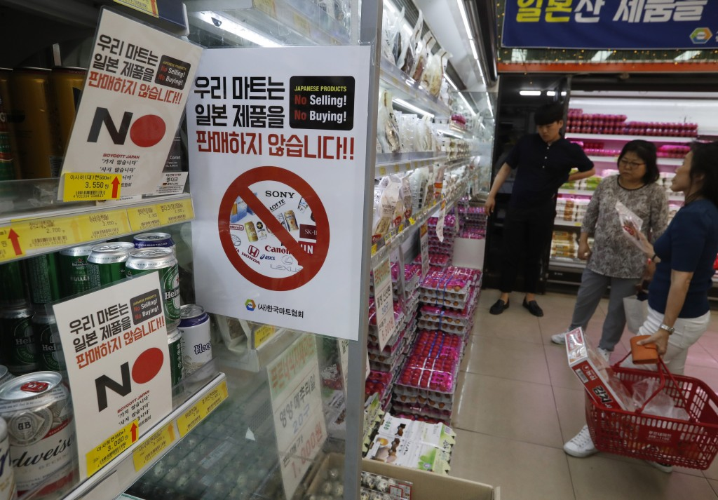 FILE - In this Tuesday, July 9, 2019, file photo, notices campaigning for a boycott of Japanese-made products are displayed at a store in Seoul, South...