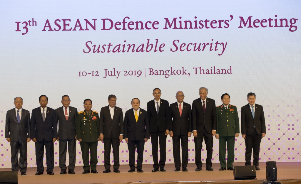 ASEAN defense ministers pose for a group photo ahead of the ASEAN Defense Ministers' Meeting Thursday, July 11, 2019, in Bangkok, Thailand. They are, ...