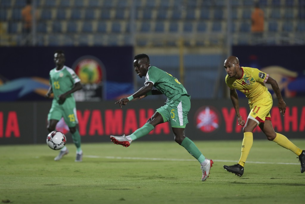 Senegal's Idrissa Gana Gueye scores during the African Cup of Nations quarterfinal soccer match between Senegal and Benin in 30 June stadium in Cairo,