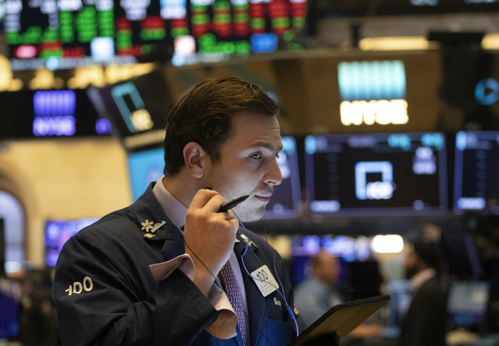 FILE - In this July 5, 2019, file photo trader Benjamin Tuchman works at the New York Stock Exchange in New York. The U.S. stock market opens at 9:30 ...