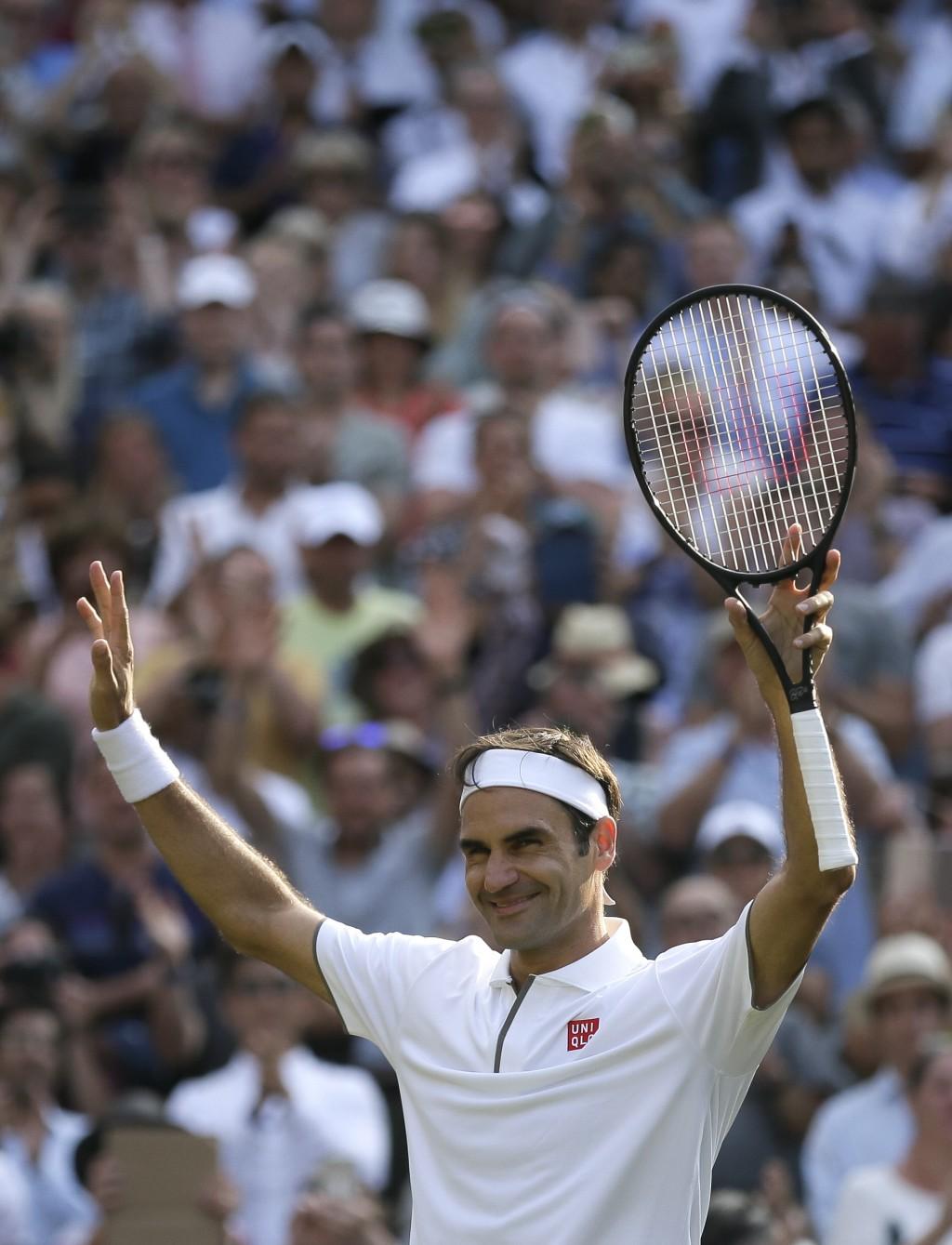 Switzerland's Roger Federer celebrates defeating Japan's Kei Nishikori during a men's quarterfinal match on day nine of the Wimbledon Tennis Champions