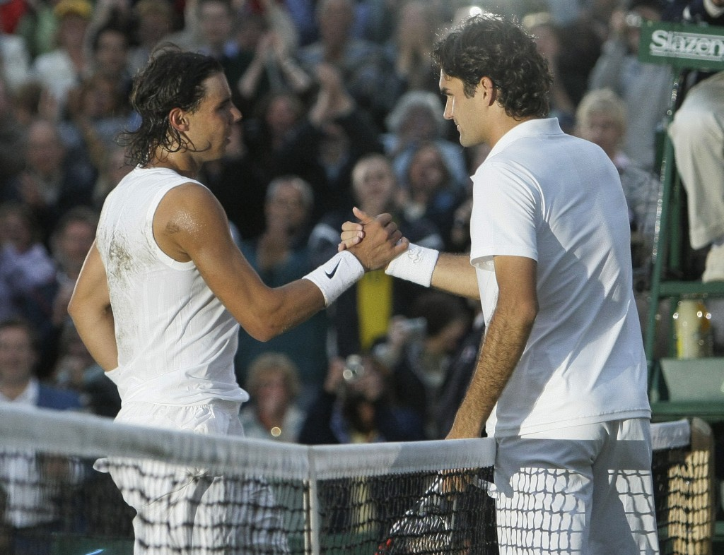 FILE - In this Sunday, July 6, 2008 file photo Spain's Rafael Nadal left, shakes the hand of Switzerland's Roger Federer after winning the men's final