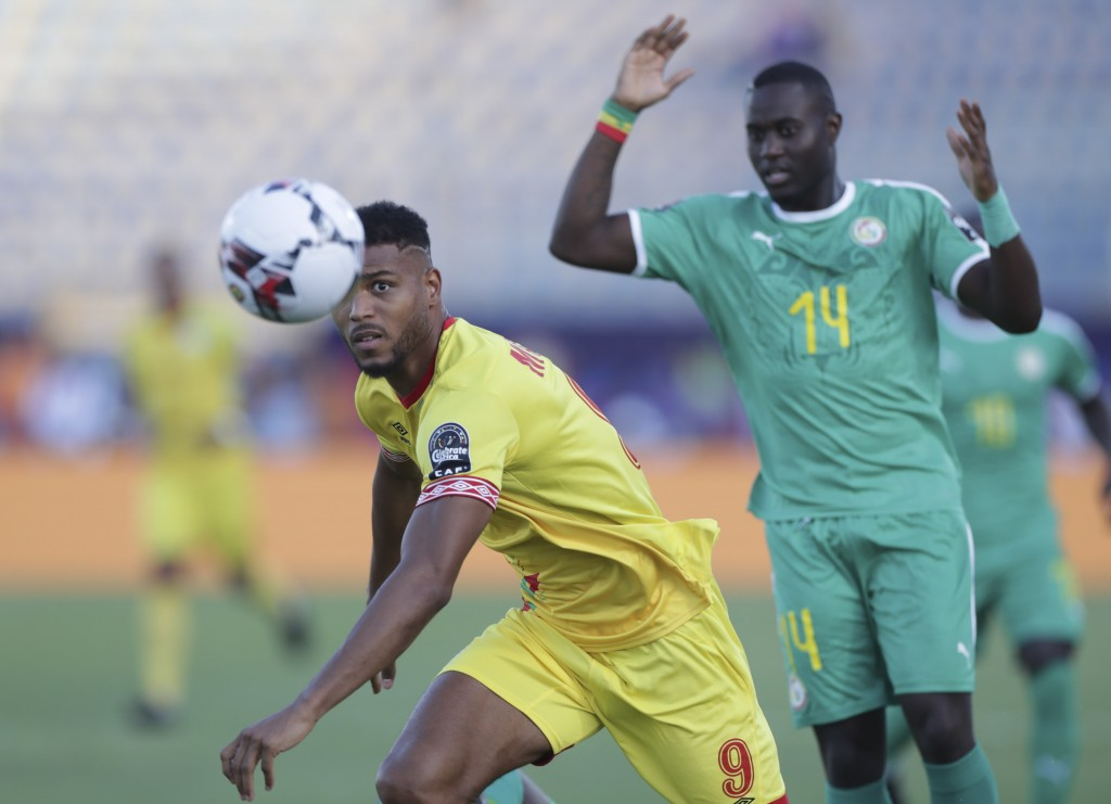 Benin's Steve Mounie in action in front of Senegal's Henri Grégoire Aivet during the African Cup of Nations quarterfinal soccer match between Senegal