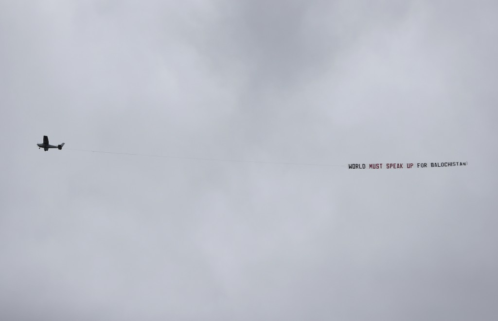"""An aircraft tows a banner that reads """"World must speak up for Balochistan"""" as it flies over the venue of the Cricket World Cup semi-final match betwee..."""