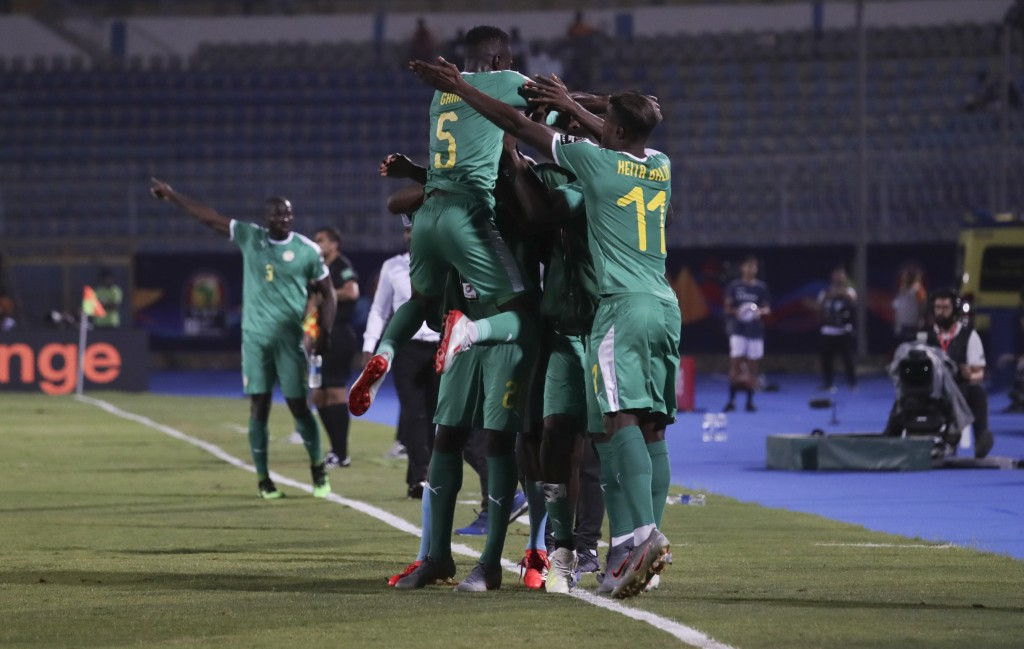 Senegal players celebrate after a goal during the African Cup of Nations quarterfinal soccer match between Senegal and Benin in 30 June stadium in Cai