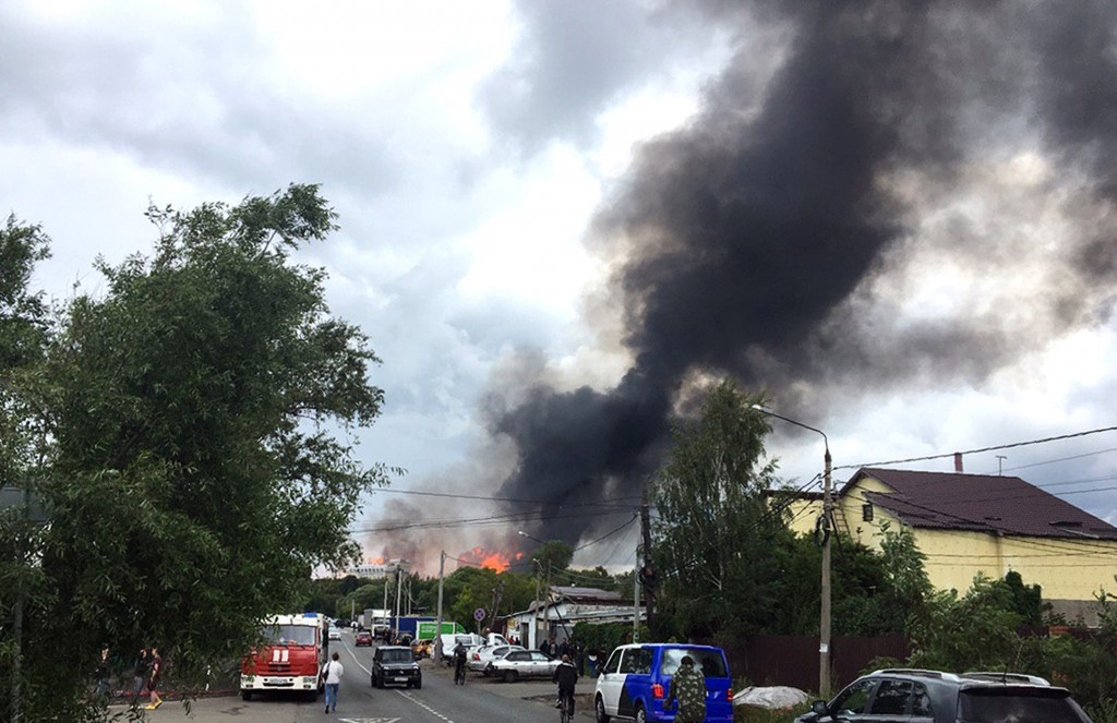 Black smoke rises over a power station, in Mytishchi, outside Moscow, Russia, Thursday, July 11, 2019.The fire broke out on Thursday on the premises o