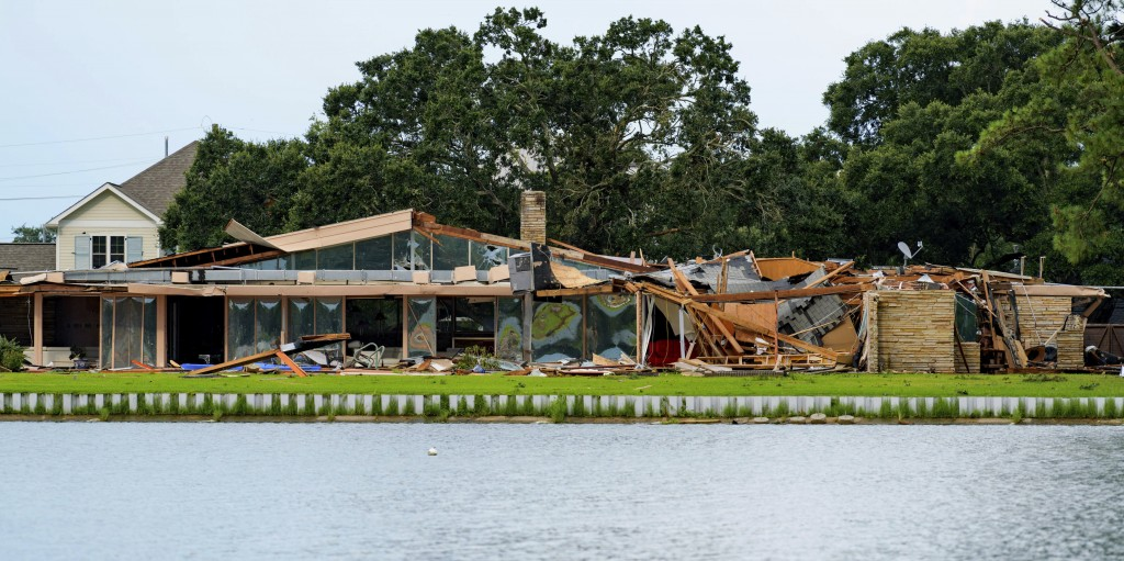 This photo shows the damaged home of Eric and Indra Ehlenberger in New Orleans on Wednesday, July 10, 2019, following a storm that went through the ar