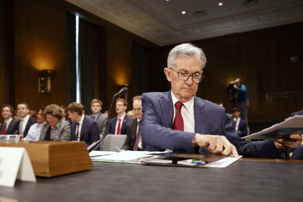 Federal Reserve Chair Jerome Powell takes his seat...