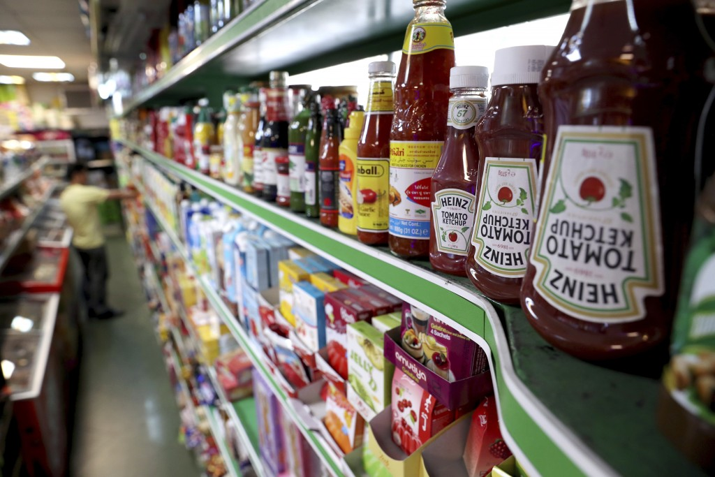 Heinz Ketchups are displayed in a grocery store in downtown Tehran, Iran, Wednesday, July 10, 2019. Whether at upscale restaurants or corner stores, A...