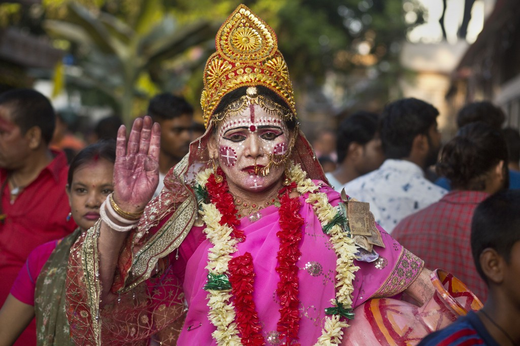 In this June 23, 2019 photo, a devotee dressed as goddess Kamakhya attends the Ambubachi festival at the Kamakhya temple in Gauhati, India. The temple