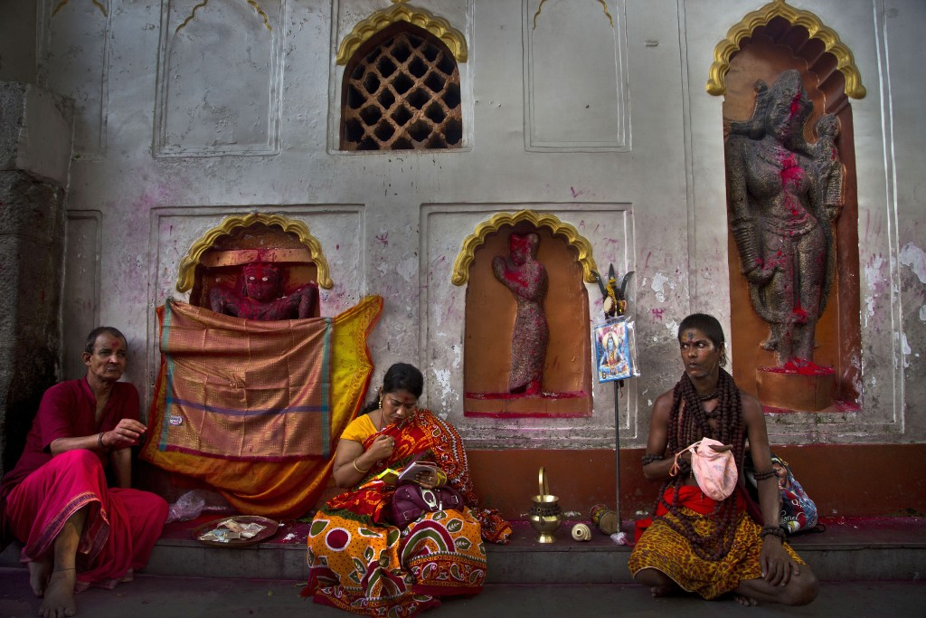 In this June 23, 2019 photo, devotees perform rituals beside idols of goddess Kamakhya during Ambubachi festival at the Kamakhya temple in Gauhati, In