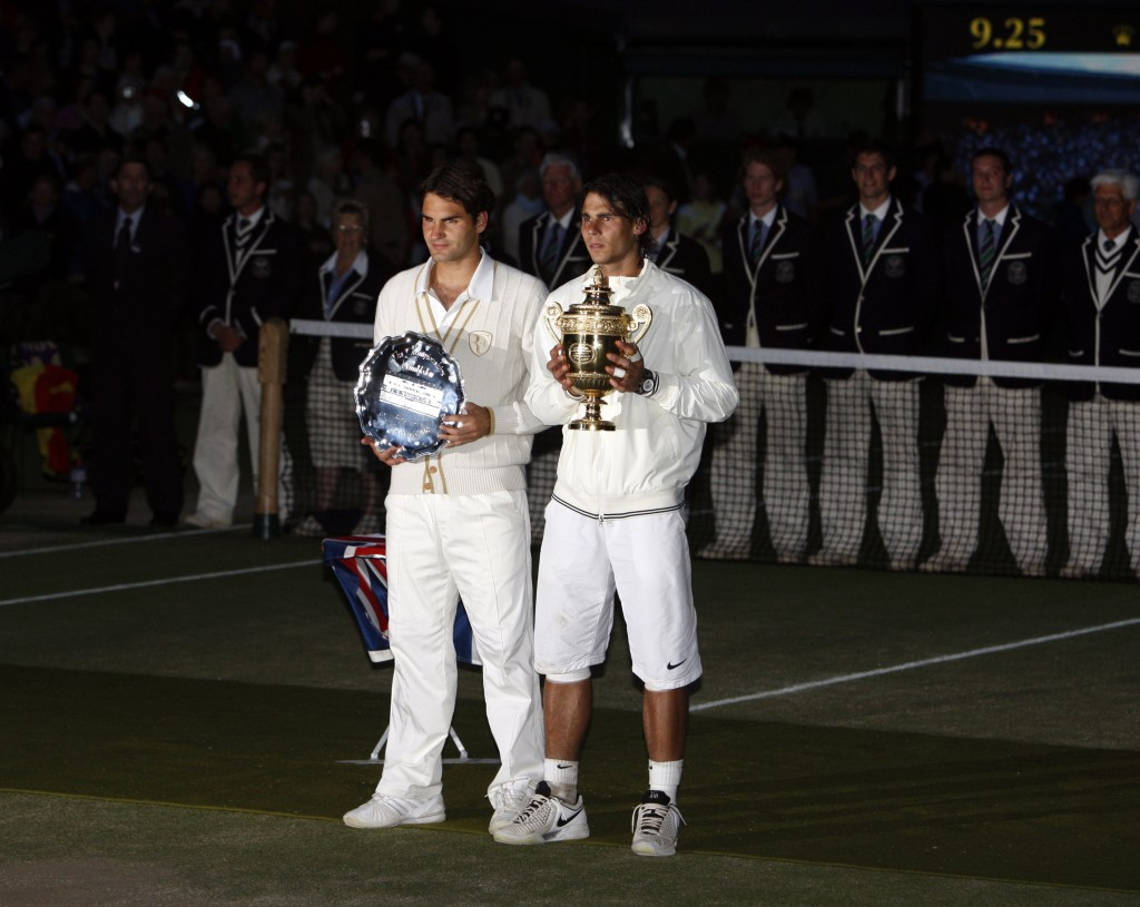 FILE - In this Sunday, July 6, 2008 file photo Spain's Rafael Nadal right, stands with the winners trophy next to Switzerland's Roger Federer after th