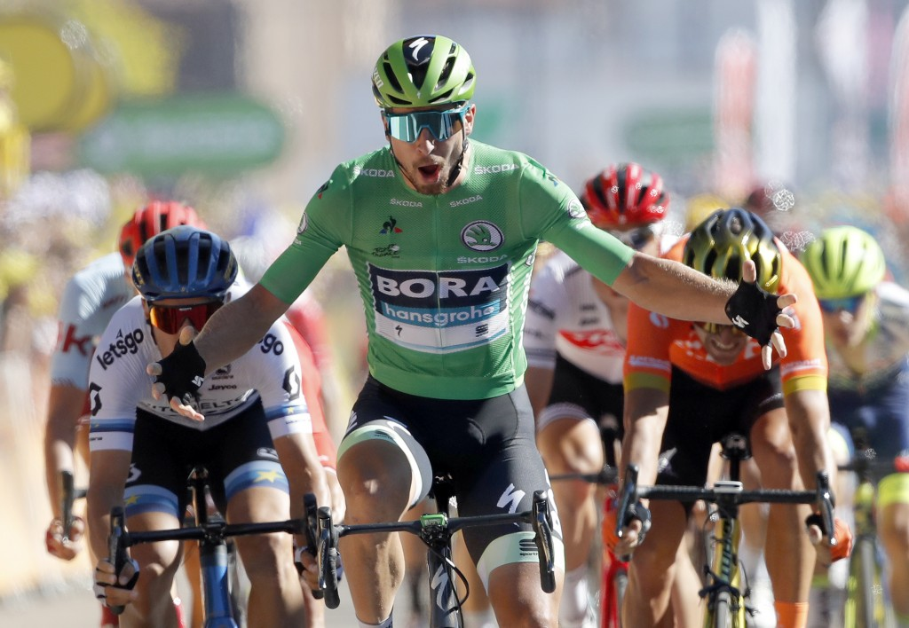 Slovakia's Peter Sagan wearing the best sprinter's green jersey celebrates as he crosses the finish line to win the fifth stage of the Tour de France ...