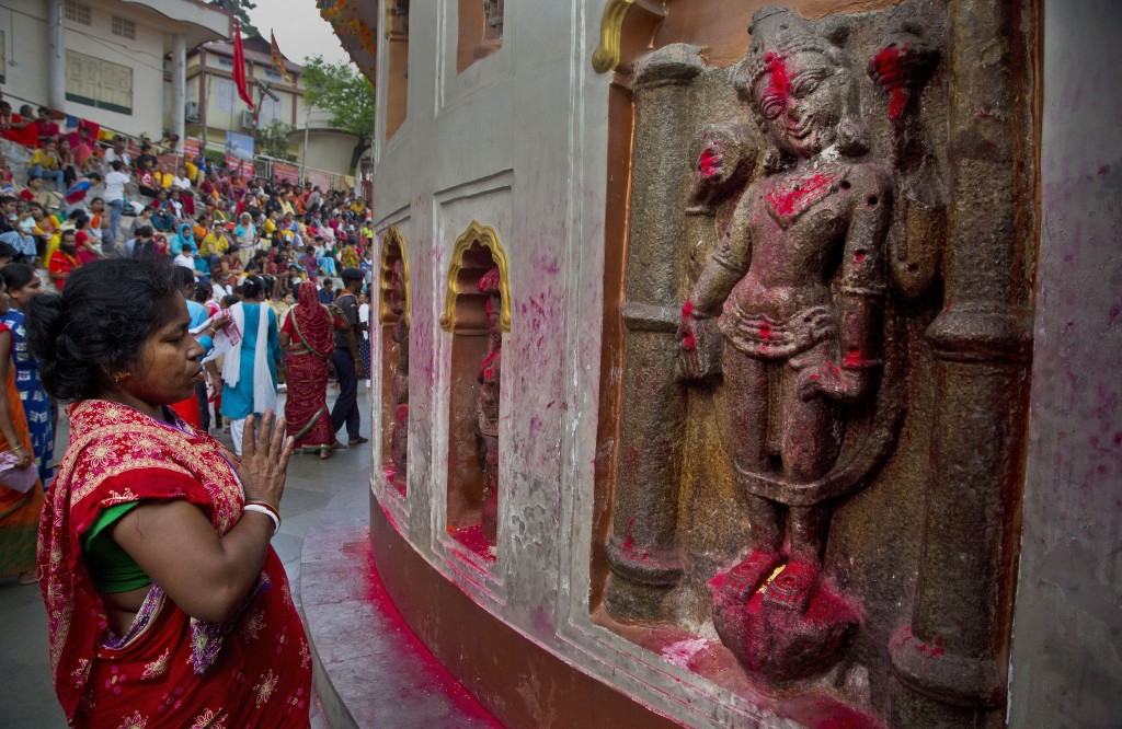 In this June 25, 2019 photo, Monika Deb Nath, 45, offers prayers at the Kamakhya temple during the Ambubachi festival in Gauhati, India. Monika, 45, a
