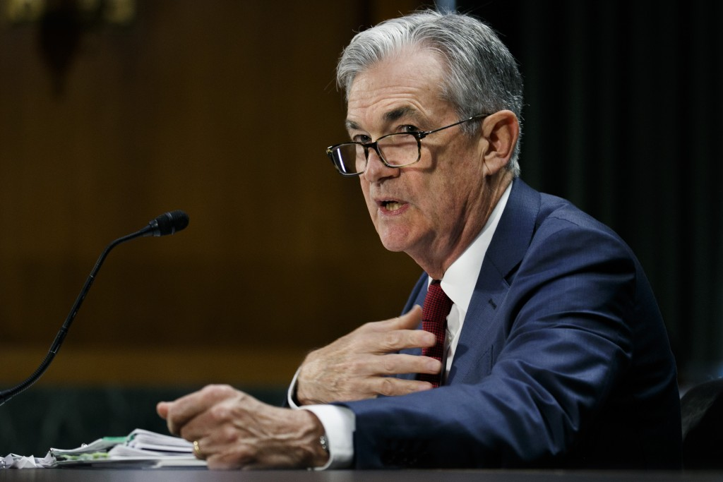 Federal Reserve Chair Jerome Powell presents the m...