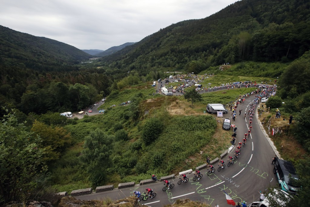 The pack rides during the sixth stage of the Tour de France cycling race over 160 kilometers (100 miles) with start in Mulhouse and finish in La Planc...