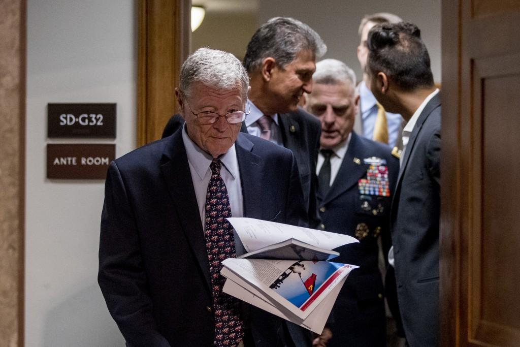 From left, Chairman Sen. Jim Inhofe, R-Okla., Sen. Joe Manchin, D-W.Va., and Gen. Mark Milley arrive for a Senate Armed Services Committee hearing on