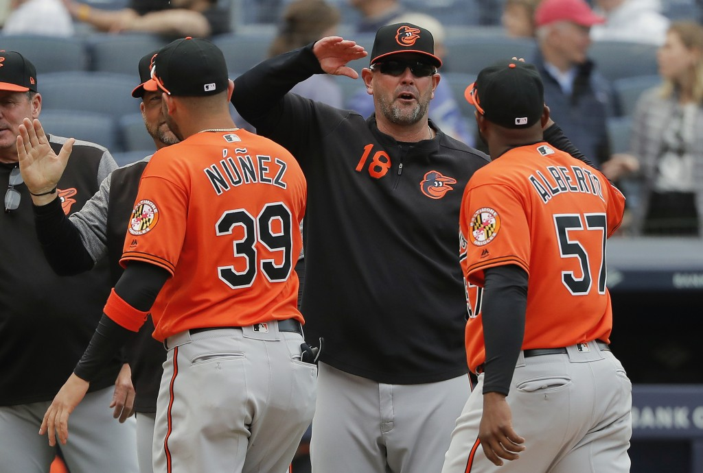 FILE - In this Saturday, March 30, 2019 file photo,Baltimore Orioles manager Brandon Hyde (18) congratulates players after they defeated the New York ...