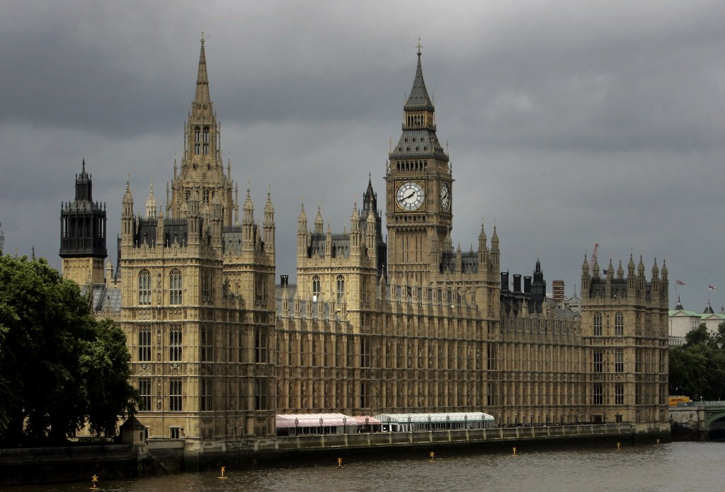 FILE - In this Thursday, July 26, 2007 file photo, a general view of the Houses of Parliament on the river Thames in London. A lawyer's investigation ...