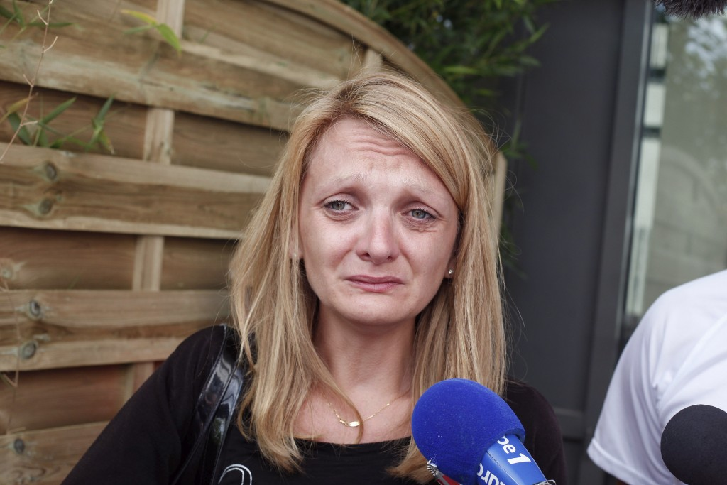 FILE - This July 23 2015 file photo shows Rachel Lambert, wife of Vincent Lambert, crying as she speaks to the media, at the Sebastopol hospital, in R