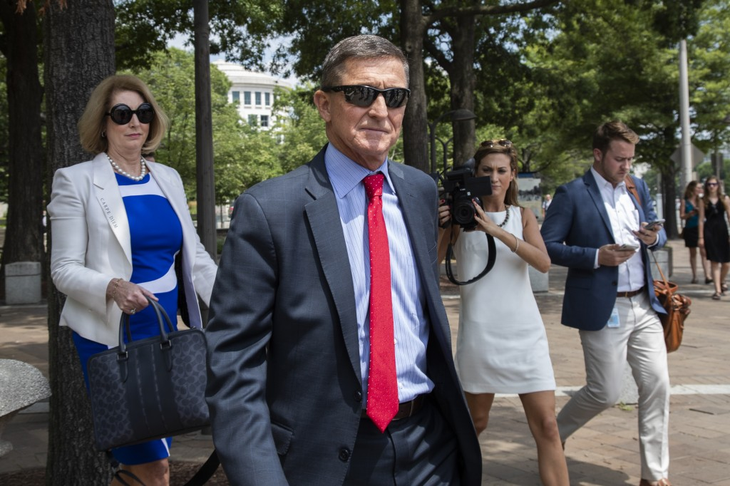 FILE - In this June 24, 2019, file photo, former national security adviser Michael Flynn, leaves the federal courthouse in Washington. with his lawyer...