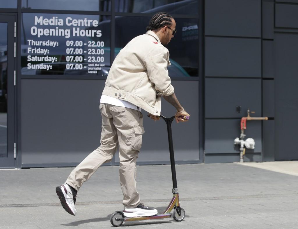 Mercedes driver Lewis Hamilton of Britain rides a ...