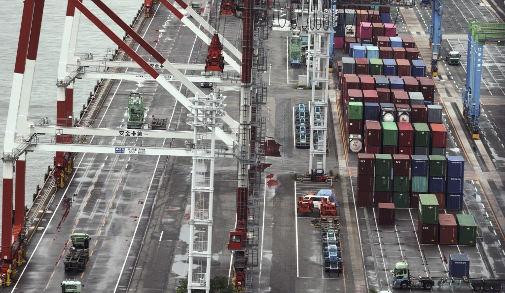 FILE - In this June 28, 2019, file photo, containers are placed at a port in Osaka, western Japan. Japan and South Korea, two major U.S. allies, are a