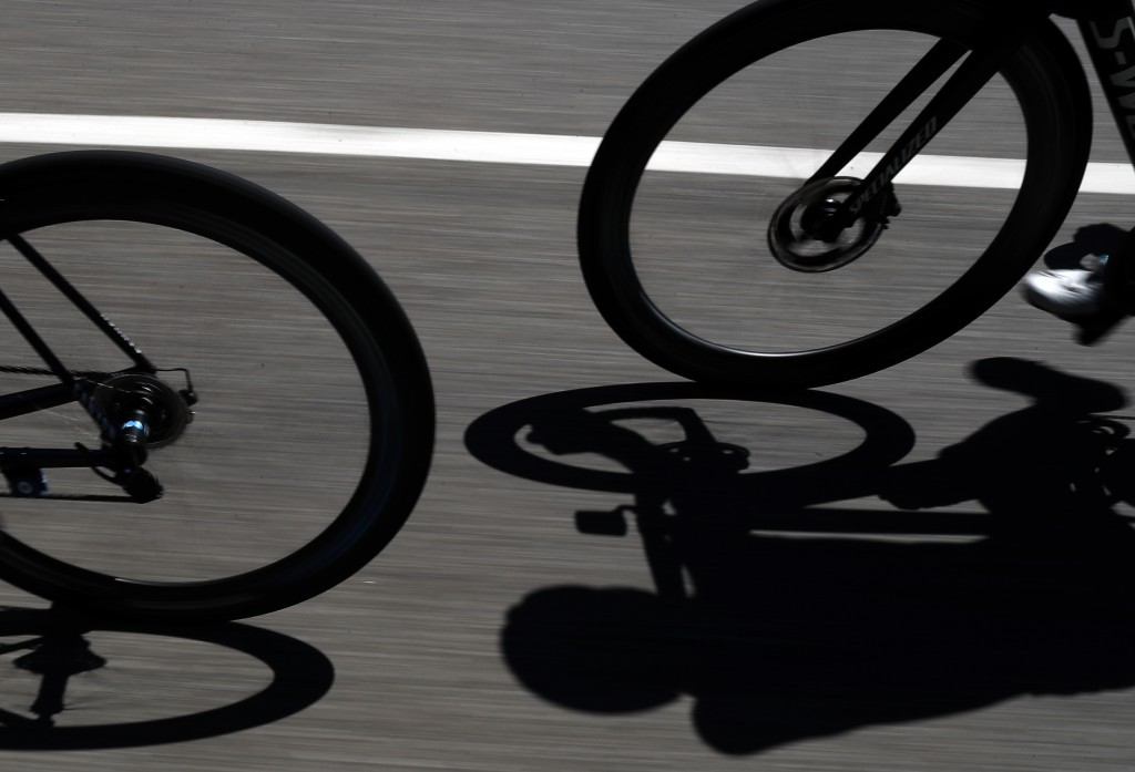 Riders cast their shadows during the fifth stage o...