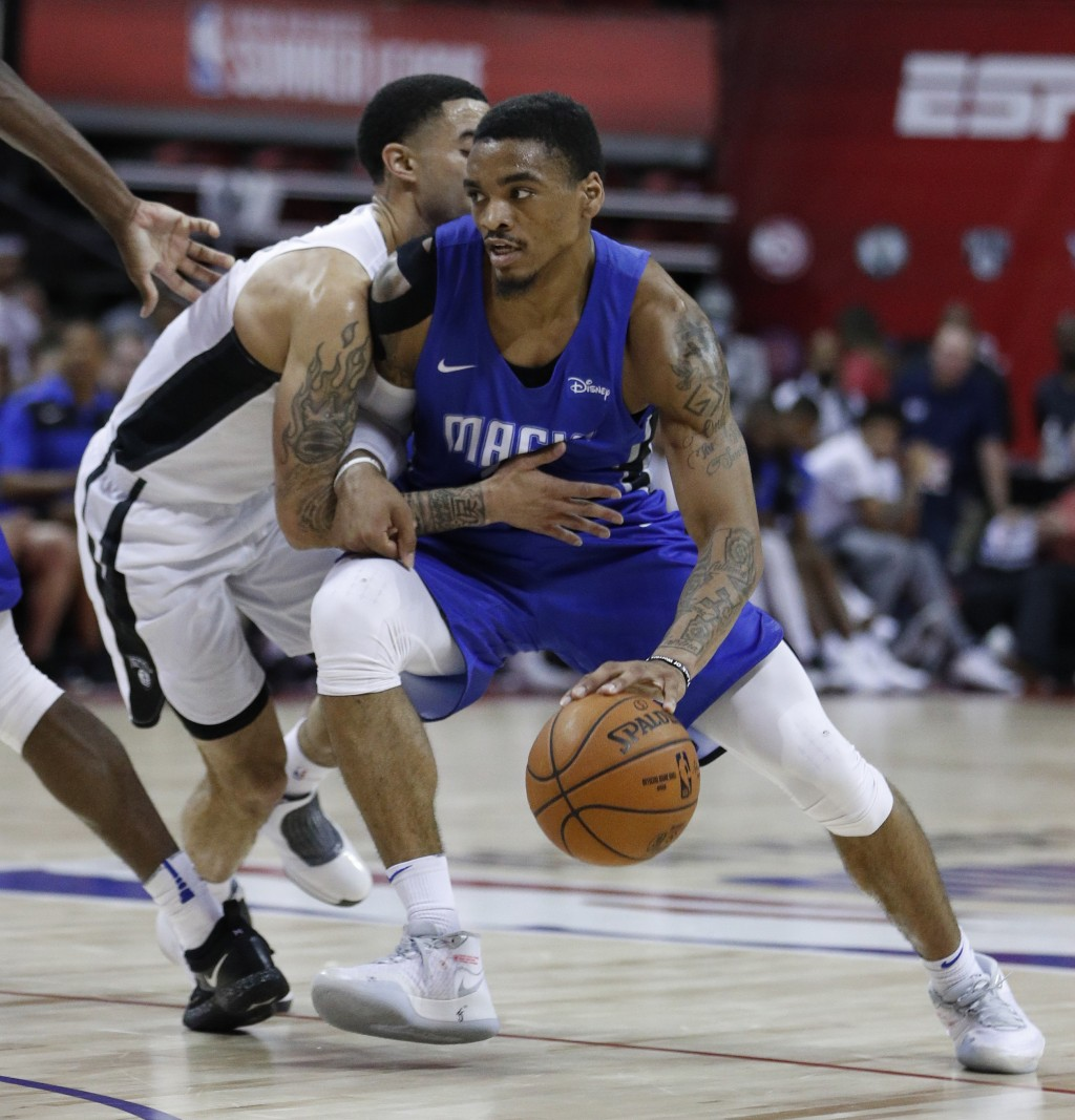 Orlando Magic's DaQuan Jeffries, right, drives into Brooklyn Nets' Josh Gray during the second half of an NBA summer league basketball game Wednesday,...