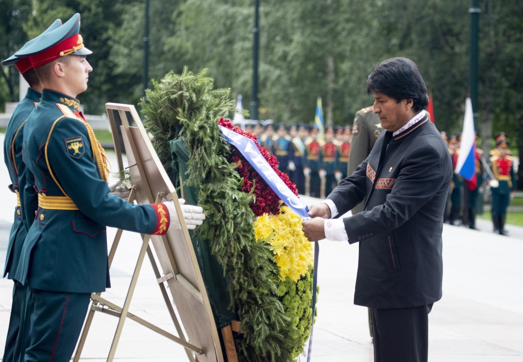Bolivia's President Evo Morales attends a wreath laying ceremony at the Tomb of Unknown Soldier in Moscow, Russia, Thursday, July 11, 2019. Morales ar