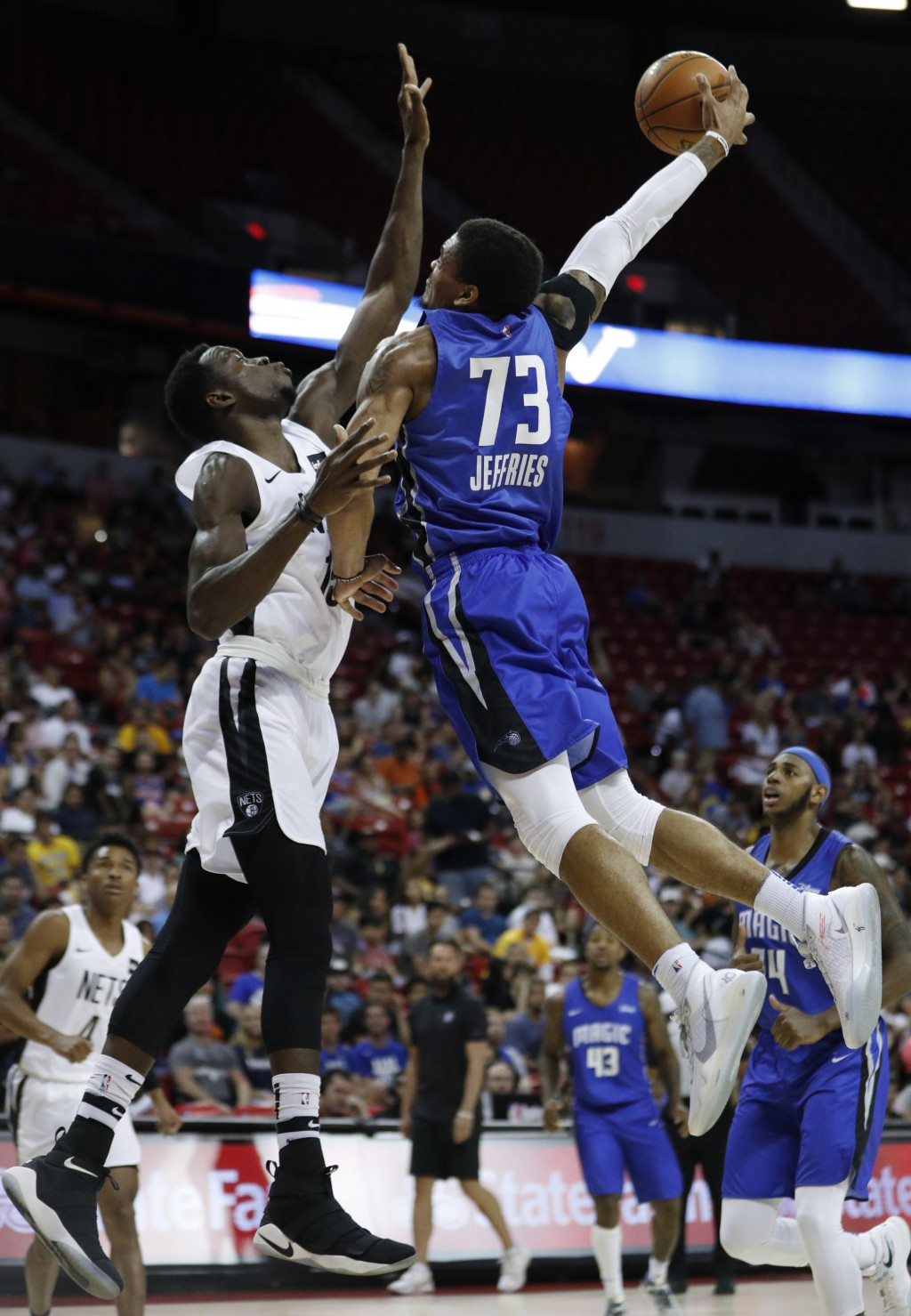 Orlando Magic's DaQuan Jeffries (73) attempts a shot over Brooklyn Nets' Amida Brimah during the second half of an NBA summer league basketball game W...