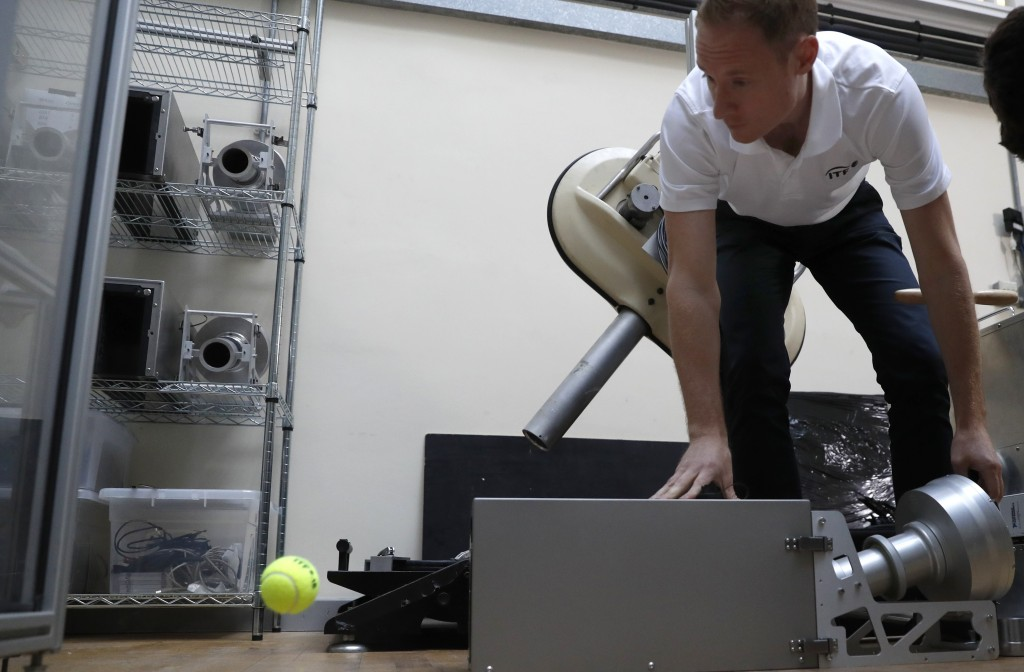In this photo taken Friday June, 28, 2019, Jamie Caple-Davies, the head of the International Tennis Federation science and technical department, shows...
