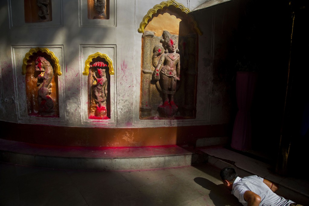 In this June 23, 2019 photo, a devotee offers prayers in front of idols of goddess kamakhya during Ambubachi festival at the Kamakhya temple in Gauhat