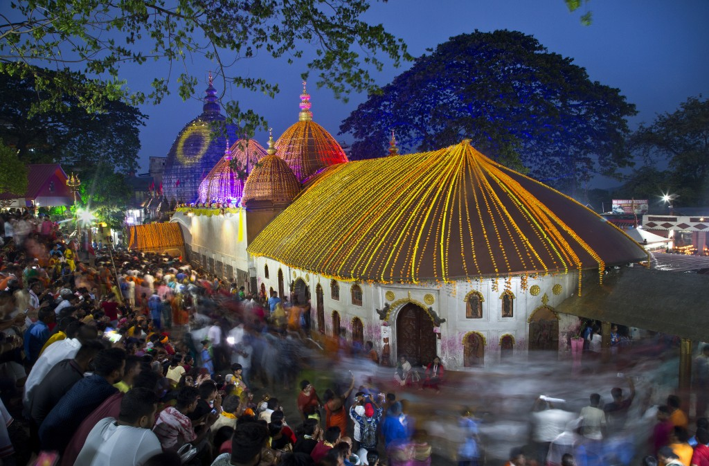 In this June 26, 2019 photo, devotees gather at the Kamakhya temple for the Ambubachi festival in Gauhati, India. The temple is presided over by the g