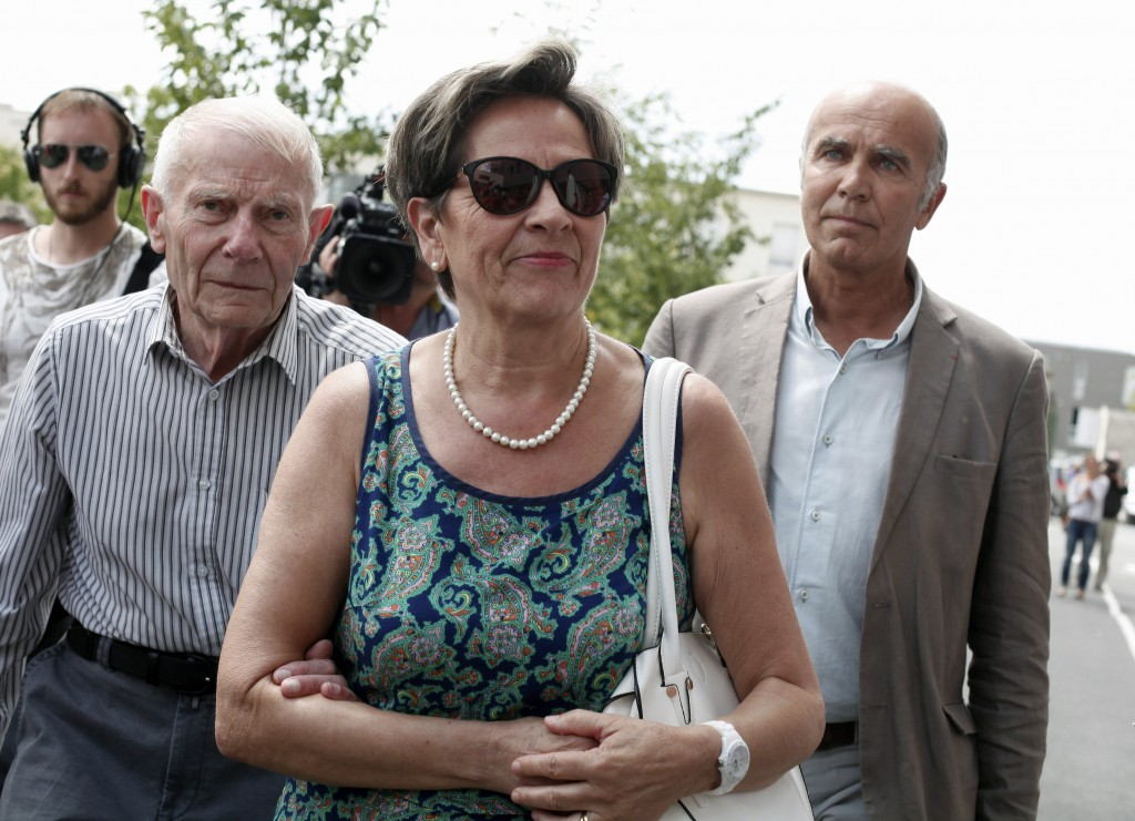 FILE - In this July 23, 2015 file photo, Viviane and Pierre Lambert, left, parents of Vincent Lambert, arrive at the Sebastopol hospital, in Reims, ea