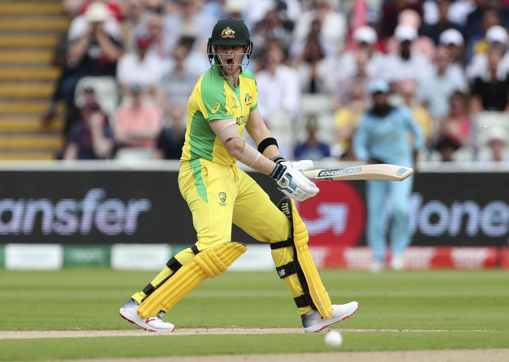 Australia's Steve Smith reacts after playing a sho...