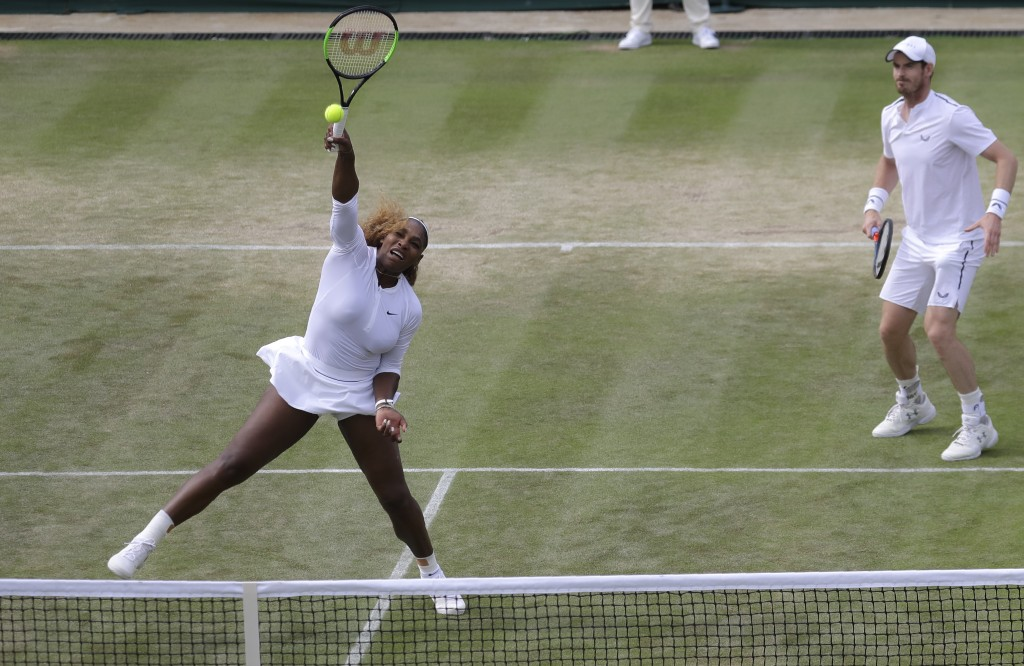 United States' Serena Williams and playing partner Britain's Andy Murray in action during a mixed doubles match against Unites States' Nicole Melichar