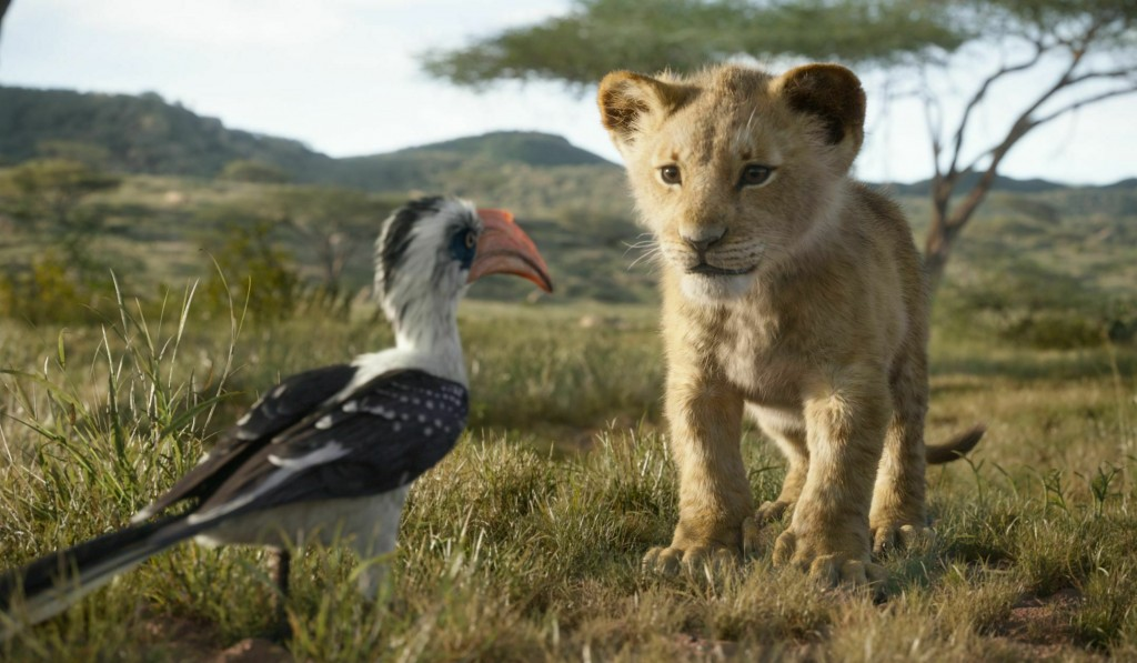 """This image released by Disney shows characters, from left, Zazu, voiced by John Oliver, and young Simba, voiced by JD McCrary, in a scene from """"The Li"""
