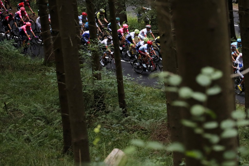 The pack rides during the sixth stage of the Tour ...