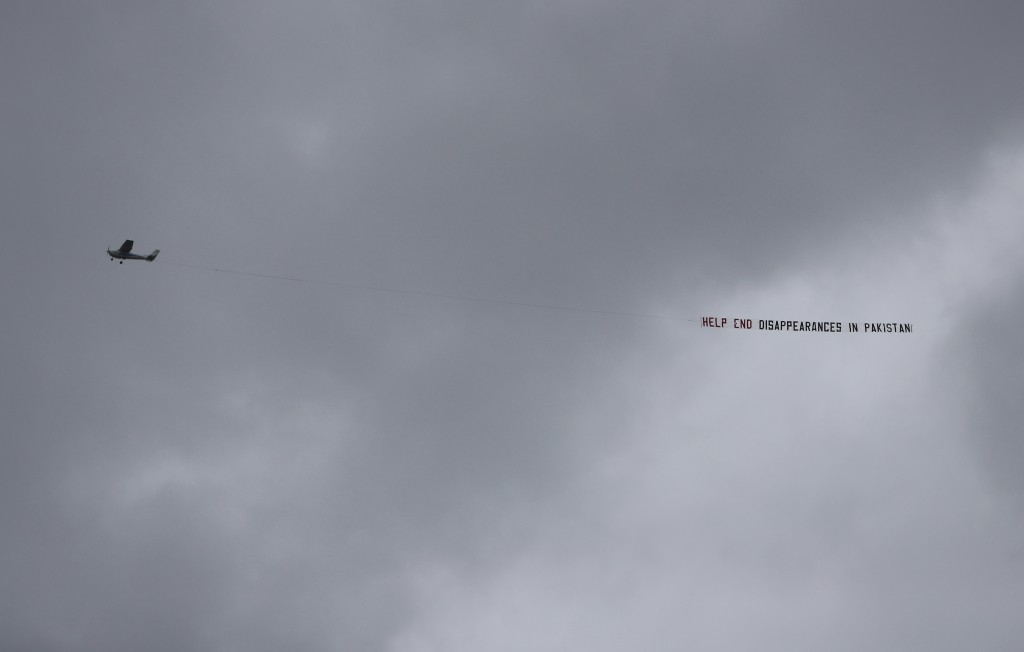 "An aircraft tows a banner that reads ""Help end disappearances in Pakistan"" as it flies over the venue of the Cricket World Cup semi-final match betwee"
