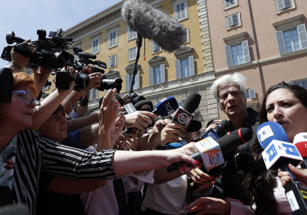 Pietro Orlandi, brother of Emanuela Orlandi who when missing in 1983, second from right, stands by his Laura Sgro as she speaks to the media after the