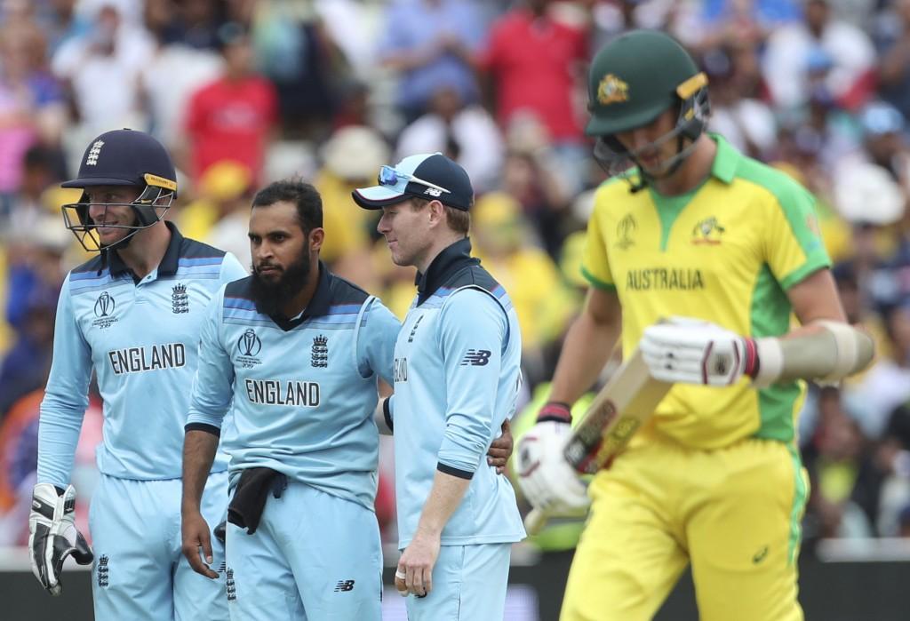 England's Adil Rashid, second left, celebrates wit...