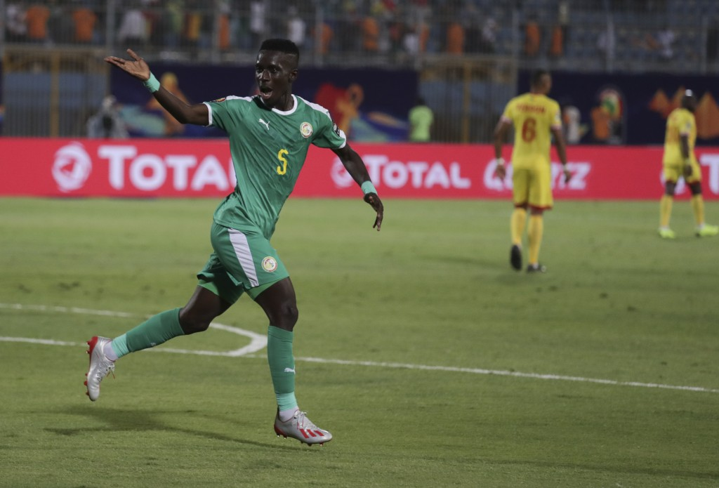 Senegal's Idrissa Gana Gueye celebrates after he scored during the African Cup of Nations quarterfinal soccer match between Senegal and Benin in 30 Ju