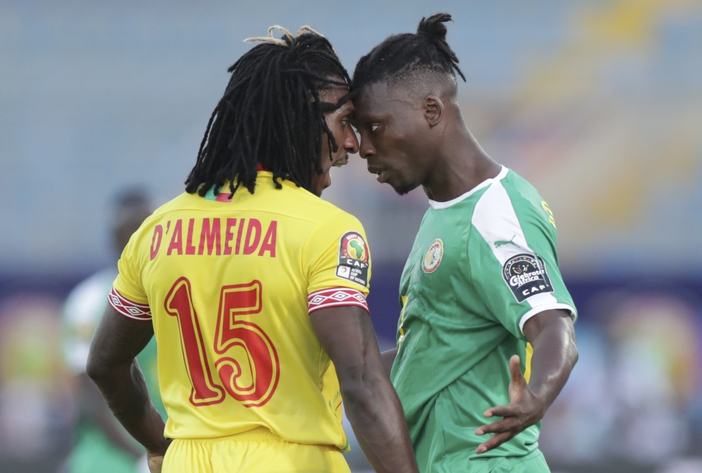 Benin's Sessi D'almeida, left, and Senegal's Lamine Gassama argue during the African Cup of Nations quarterfinal soccer match between Senegal and Beni