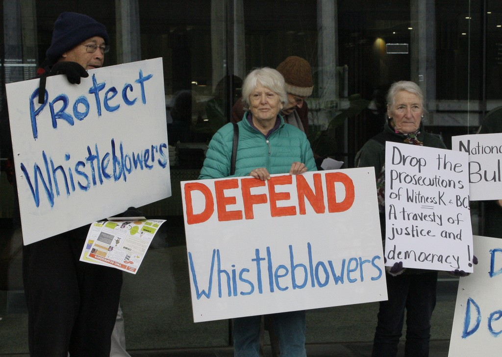 FILE - In this June 27, 2019, photo, whistleblower supporters demonstrate outside the Australian Capital Territory Supreme Court in Canberra, Australi