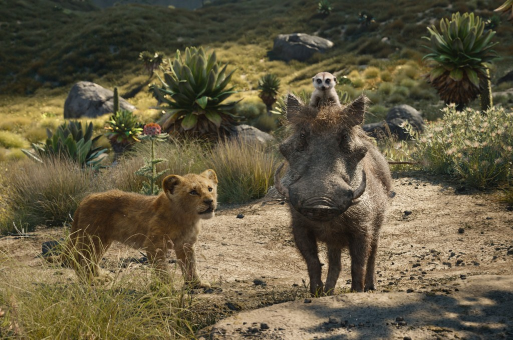 This image released by Disney shows, from left, young Simba, voiced by JD McCrary, Timon, voiced by Billy Eichner, and Pumbaa, voiced by Seth Rogen, i