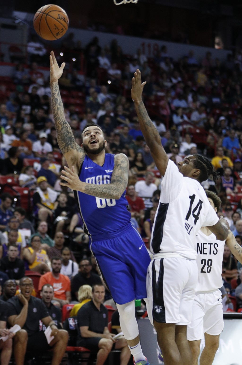 Orlando Magic's Gabe York, left, shoots around Brooklyn Nets' Ahmed Hill during the second half of an NBA summer league basketball game Wednesday, Jul...