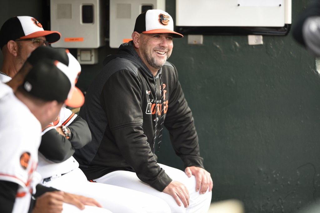 FILE - In this Tuesday, April 9, 2019 file photo, Baltimore Orioles manager Brandon Hyde sits in the dugout before playing the Oakland Athletics in a