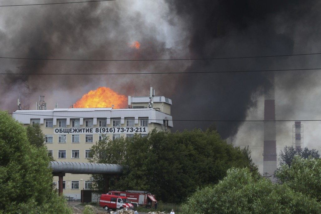 Black smoke and flames rise over a power station, in Mytishchi, outside Moscow, Russia, Thursday, July 11, 2019.The fire broke out on Thursday on the